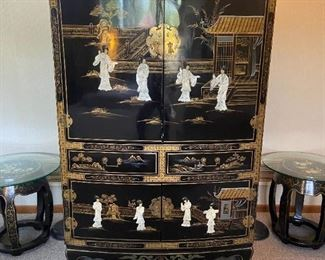 Asian lacquered cabinet with inlaid figures. Interior television storage and drawers below.  Matching barrel stools . Set of floor lamps also pictured.