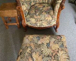 Hand carved antique club chair and foot stool.