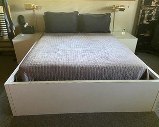 Queen bed with mattress and box spring including formica bed frame.