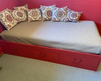 Single twin bed with mattress and storage.