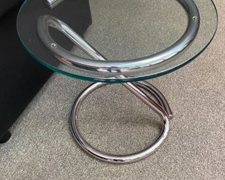Two glass topped end tables.