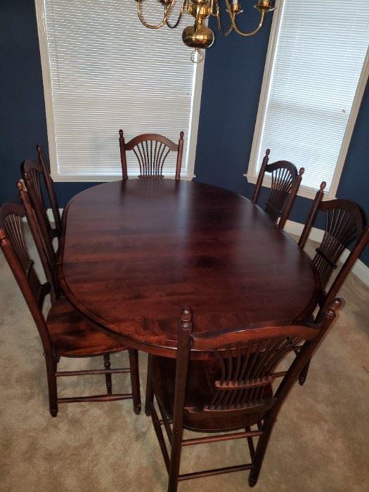 Custom built birch dining set w 1 leaf from Canadel.  $950