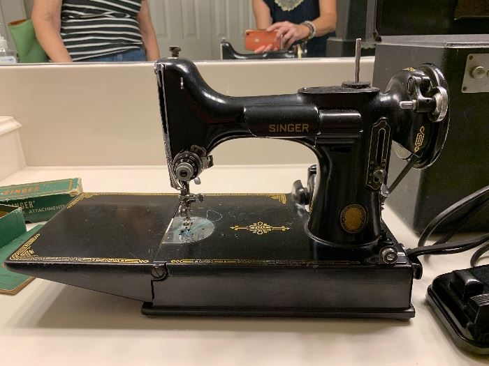Vintage Featherweight Singer Centennial Sewing Machine has original case, instructions, additional pieces. In excellent working condition; looks new!