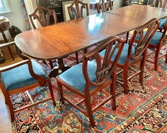 """$1,200 - Vintage inlay and banded dining room table with three pedestals and brass claw feet and casters; 30"""" H x 96"""" L x 37"""" W"""
