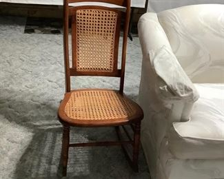 Vintage rocker with woven seat and back