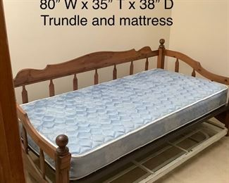 Daybed with Trundle that pops to meet the other frame level.  One Twin mattress