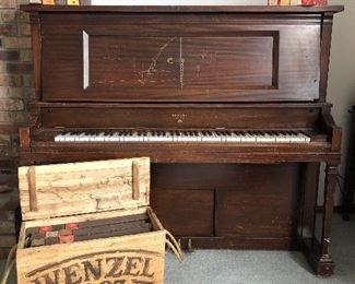 Player piano with over 150 music rolls