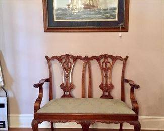 Chippendale-style settee under great sailing print