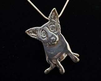 Louisiana artist George Rodrigue's Blue Dog in sterling. Pendant and chain sold together.