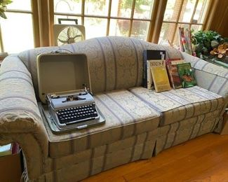 sofa, typewriter, nice books