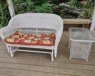 Outdoor wicker glider; white glass top side table