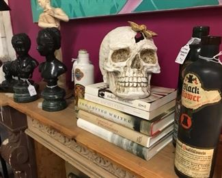 Old books, wine bottles and statues
