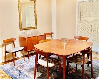 Danish modern teak dining table and 6 chairs, two leaves