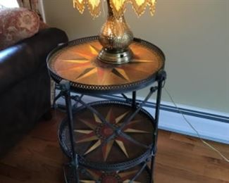 Regency style metal table with painted leather, Middle Eastern pierced brass lamp