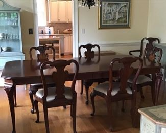 Stunning Maitland Smith dining set with 6 straight chairs, 2 arm chairs, and 2 extensions! Priced to sell!