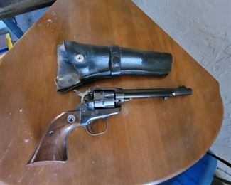 Vintage revolver and leather case