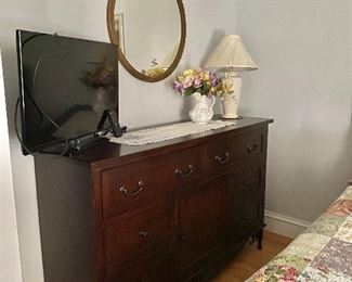 Sold ladies dresser.  Also featuring flat screen tv, mirror and decor.