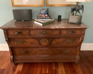 Full size Eastlake dresser with pink marble top.  So much storage - could be used in the bedroom or as a Buffet in your dining room.  SO much storage and a rare find!