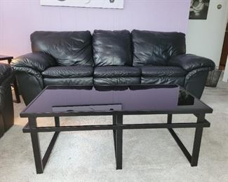 "$60, Black metal and glass coffee table  52""x 17""x29.5"""