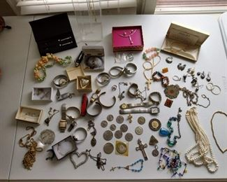 Various pieces of jewelry and coins