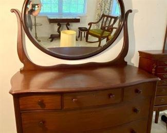 """1- $450 Mahogany dresser with oval mirror C. 1920's – 51""""L x 24""""D x 6'H"""