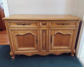 "Solid Wood Buffet/Sideboard, by Metz, J. L. Furniture Co. USA.  Two drawers felt lined for silverware, plus 2 side storage areas with shelves.  Great condition!  53.5"" wide, 34.25"" tall, 21"" deep."