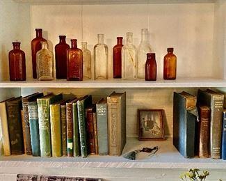 Many Vintage Books and Bottles
