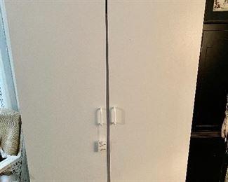 Several White Storage Cabinets