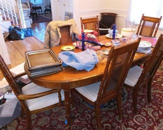 Dining table with cane back chairs