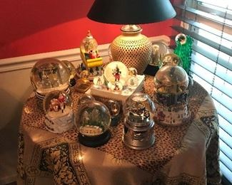 Table with Versace covering and snow globe collection