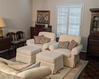 Cream colored club chairs with matching ottomans. Cream color sofa, drop leaf table with chairs, sideboard and China cabinet. Artwork, lamps & decor.