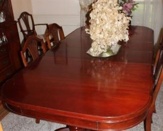Dining room table appears to have never been used although we know different, excellent condition