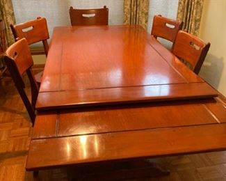 1920s solid maple dining table with pull-out leaves, trestle legs, and 6 chairs