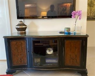 "low chest with center glass door, brown decorated and black 55"" x 21"""