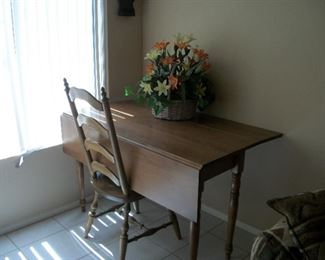 table, 2 chairs, floral arrangements