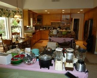 Oh do we ever have kitchen stuff, make sure you look under that tables too (we ran out of room).