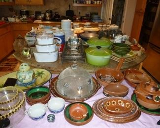 Oh to see the kitchen ware...so many dishes and some very old and lovely.