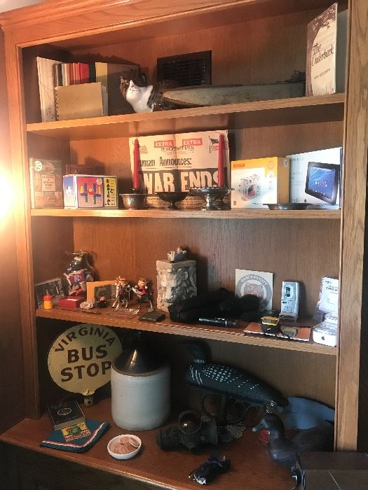 Gwen Frostic series of books on top, along with a early small battery operated toy boat! Made in Detroit by Lepage Motors! Other collectibles include a old duck decoy, duck weather vane topper, old bus stop sign and more!