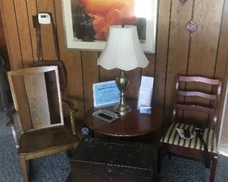 Antique Oak rocker, couple of boxes with lids, piecrust table, Hand Blown glass orbs on the wall.