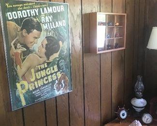 Original framed print, small trinket wall box. In the corner is a hurricane lamp, barometer and clock.