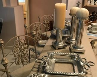 Heavy aluminum serving pieces and candle holders.