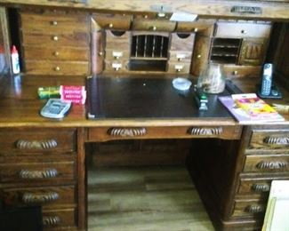 """Oak Crest"" roll top desk.  Solid Oak.  Lockable with key provided.  Secret hiding compartments."