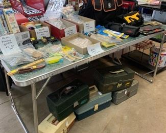 Lots of Fishing lures and tackle boxes