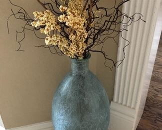 Very tall vase with flowers