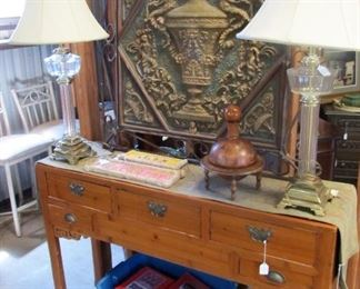 Beautiful rustic hall/foyer table, leather decanter, brass/glass lamps pair, metal relief art,