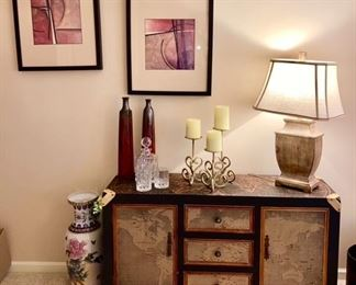 Cabinet w/ World Map decor, decorative items, crystal decanter & glasses, lamp is SOLD, signed artwork, large vase is SOLD