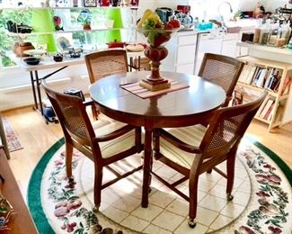 Kitchen table & 4 chairs on wheels, area rug etc.