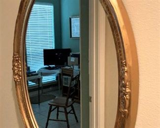 Gold toned mirror