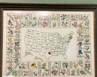 Hand-stitched map of the USA featuring state flowers