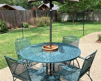 Table, 4 chairs, and umbrella